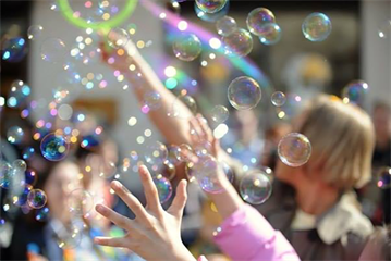 Soap bubbles, spring weather, and happy crowd make one fun afternoon!